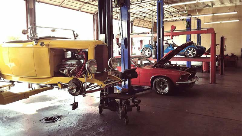 Phoenix mechanic shop with classic cars on lifts for repairs
