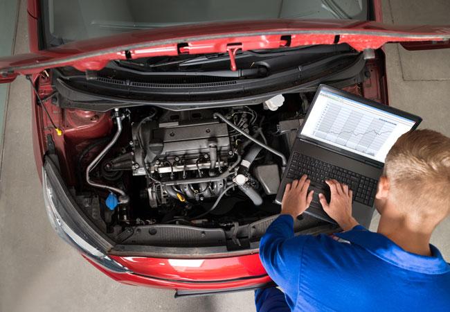 Engine diagnostic check for red car at Phoenix repair shop