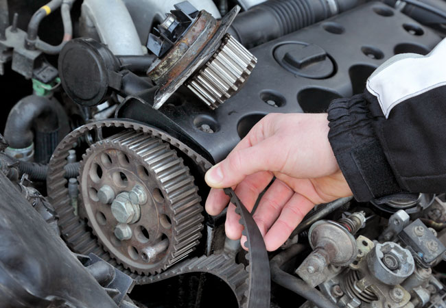Mechanic shows why vehicle needs timing belt repair in Phoenix
