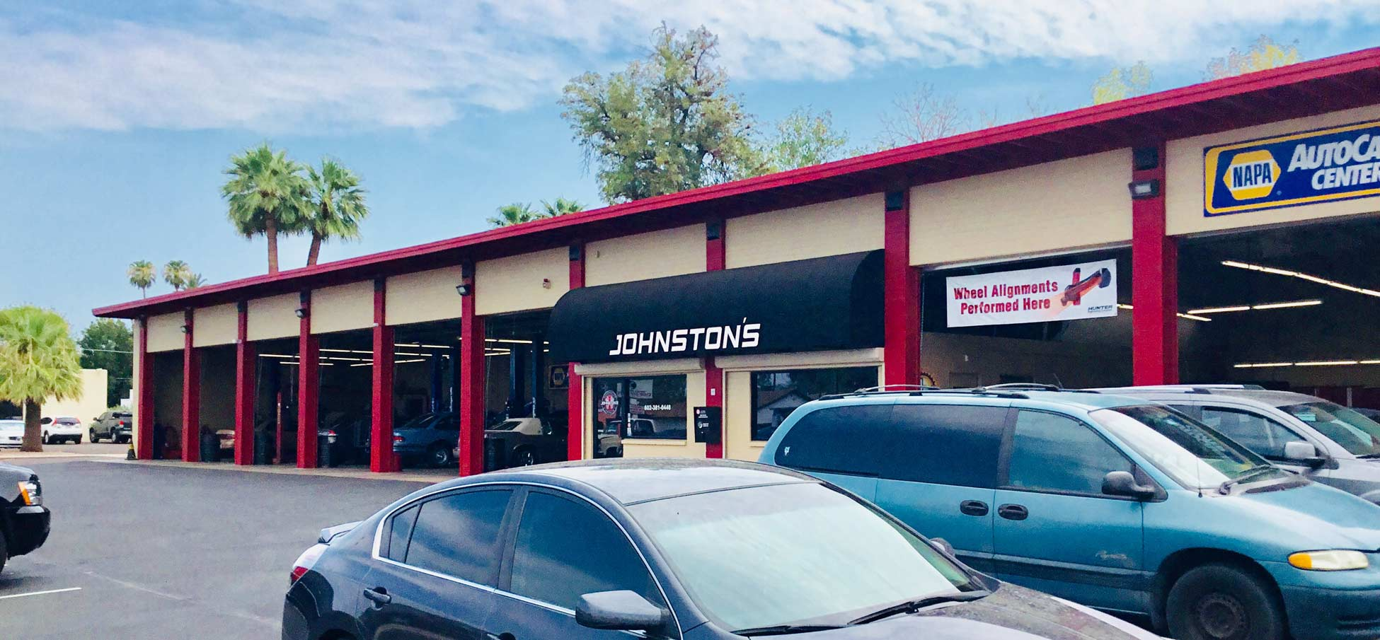 Front of Johnston's Automotive entrance and garage bays
